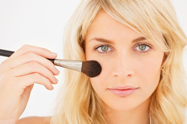 woman blush brush makeup