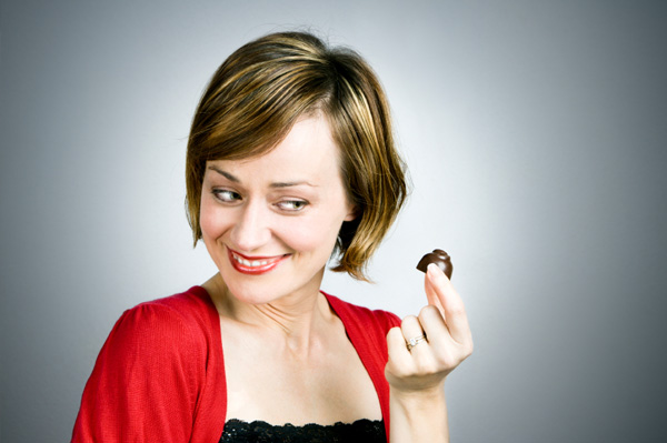 Woman looking at dark chocolate