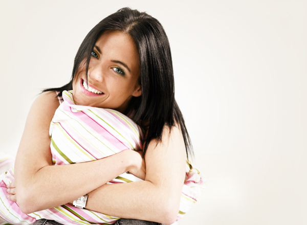 Woman squeezing pillow
