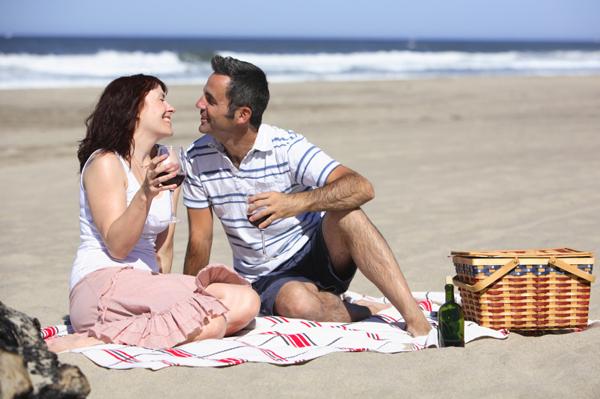 Couple eating on beach