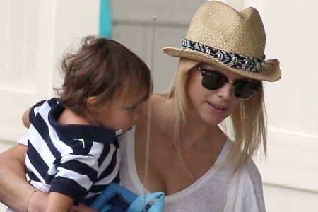 Elin Nordegren takes a Tiger cub out for the day