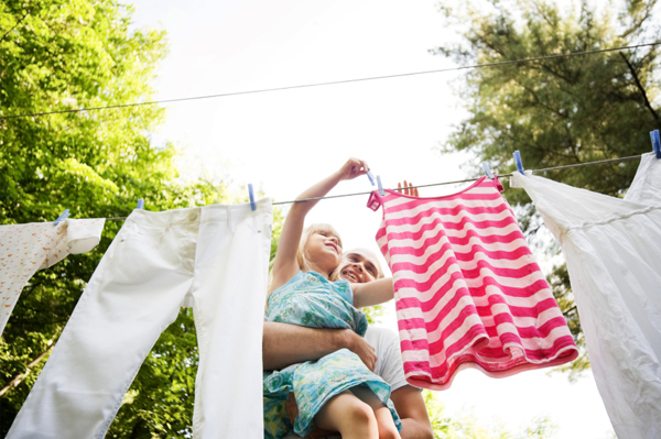 Mom and daughter hanging laundry