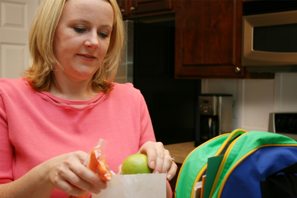 Mom packing lunch for school