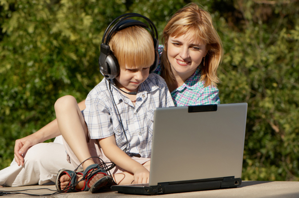 Mom and son creating summer playlist