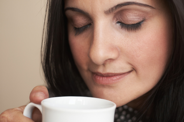 Woman drinking coffee, taking time out for mom
