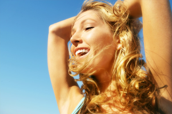 Woman with wavy hair in the wind
