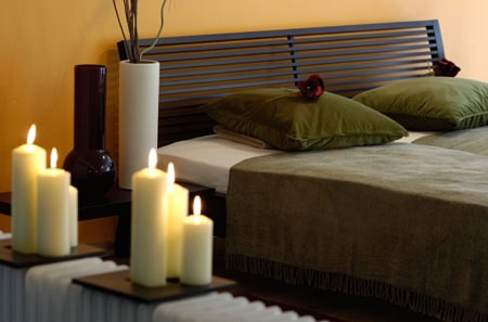 Candles are a very calming accent to any bedroom.