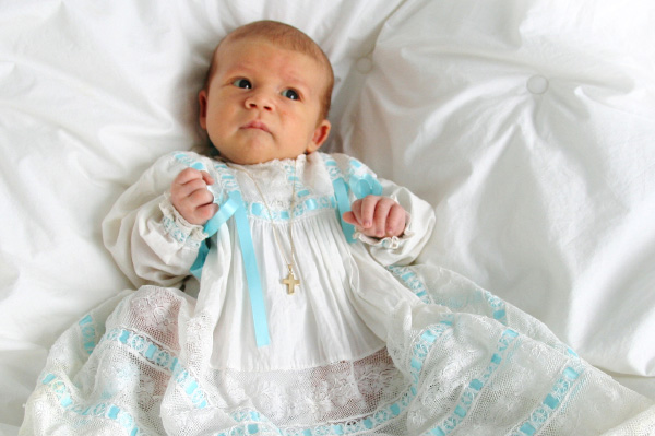 Boy in baptism clothes