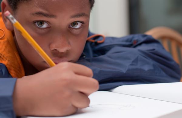 boy writing in class