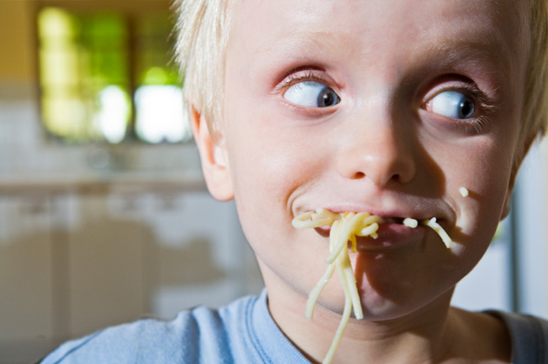 child eating with bad manners