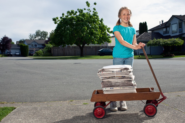 Girl delivering nespaper