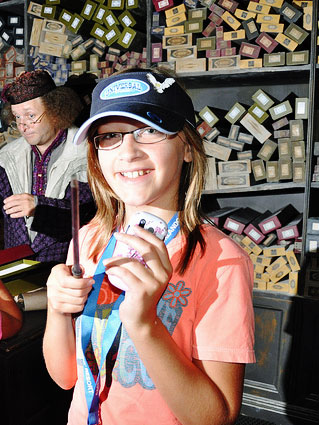 hannah at ollivander's wand shop wizarding world of harry potter universal orlando