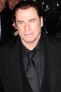 Travolta drops extortion charges