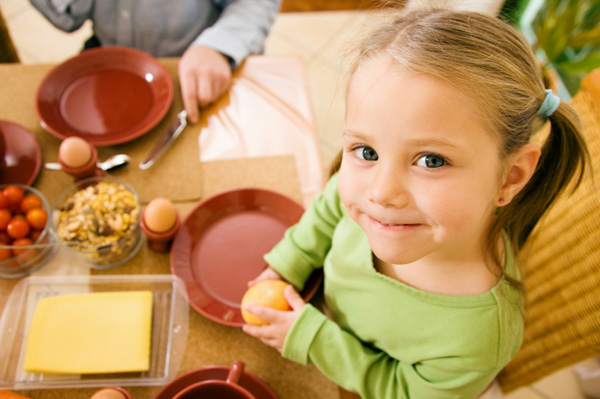Little girl with table manners