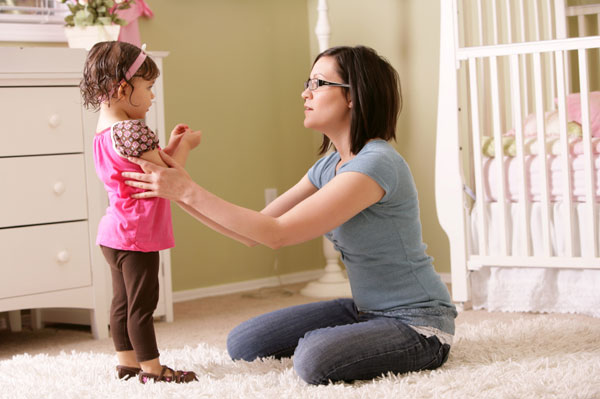 Mom talking to toddler girl