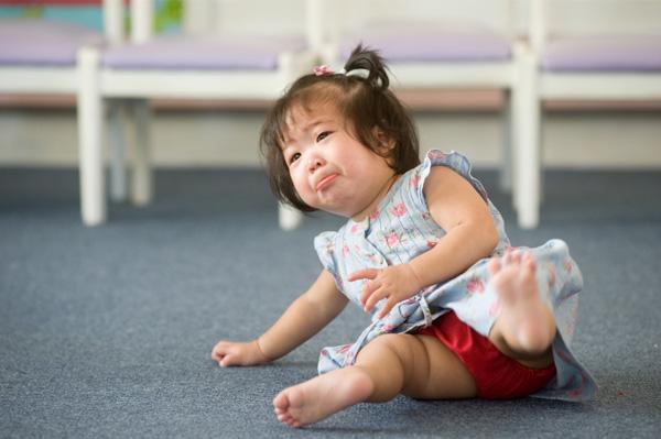 Toddler girl falling down