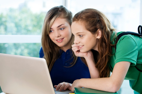 Tween girls on computer