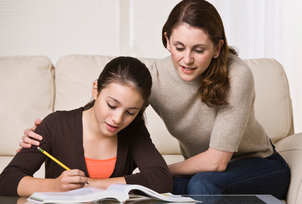 girl doing homework with mom