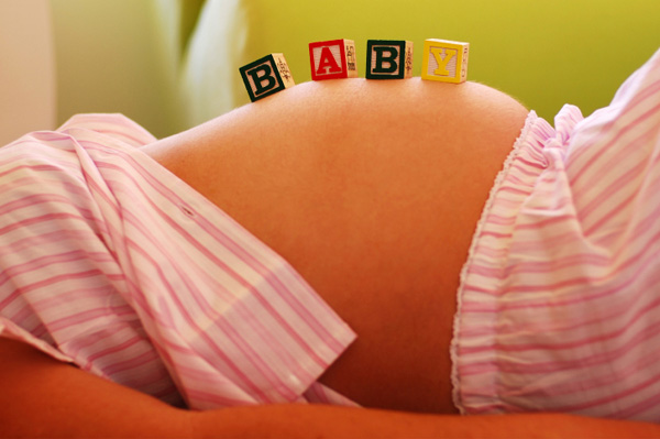 Pregnant woman with baby blocks