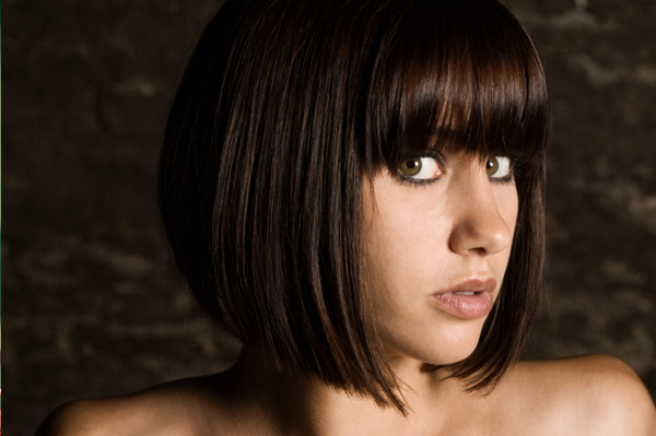 round face hairstyles with bangs. Woman with angs