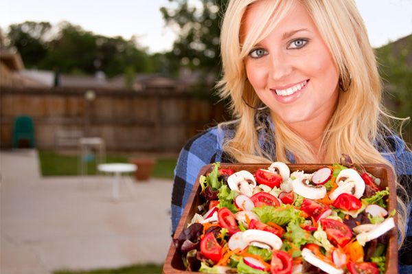 Woman with farmer's market salad