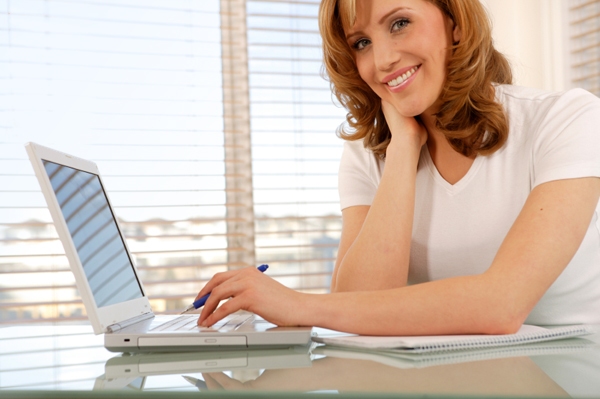 Woman workng at home on computer