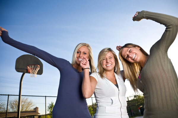 Women friends at basketball court