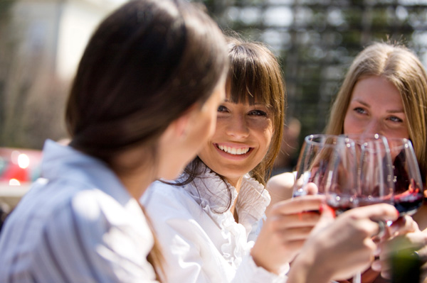 Women friends drinking wine