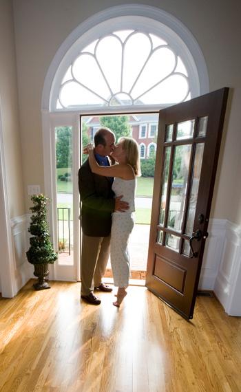 Couple kissing goodbye