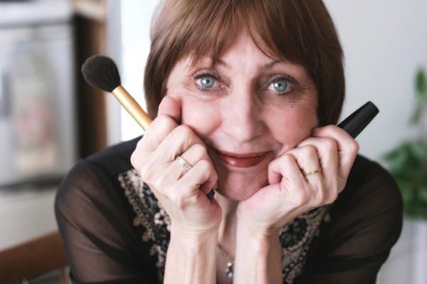 Mature woman applying makeup