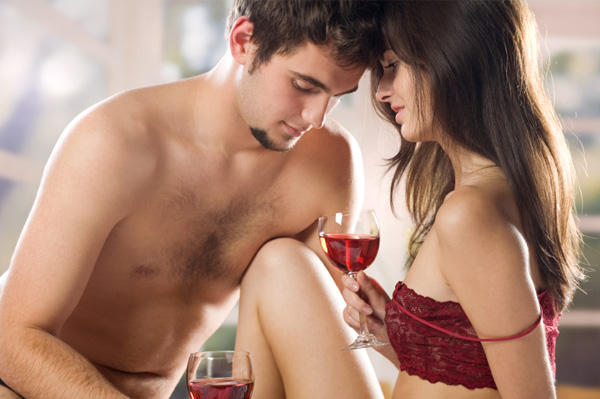 Sexy couple drinking wine