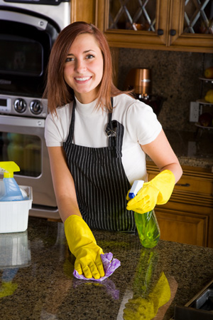 Woman cleaning countertops
