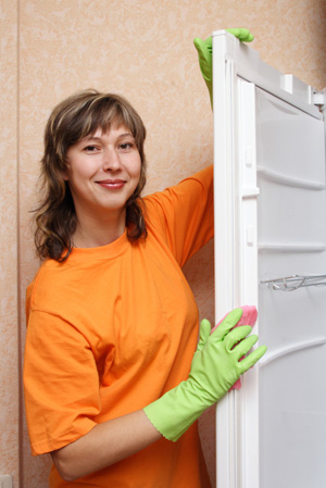 Woman cleaning refridgerator