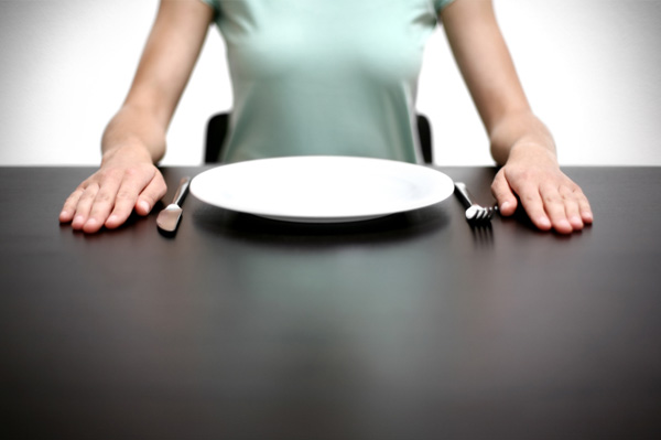 Woman with empty plate