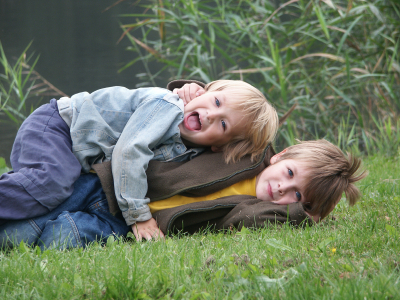 Brothers playing outside