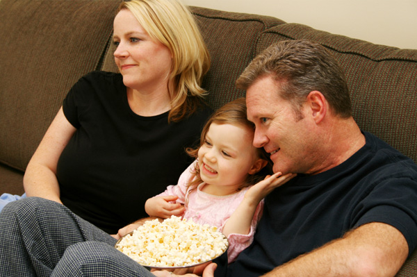 Family watching movie at home
