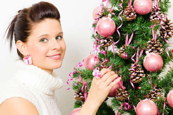 Woman with pink Christmas tree