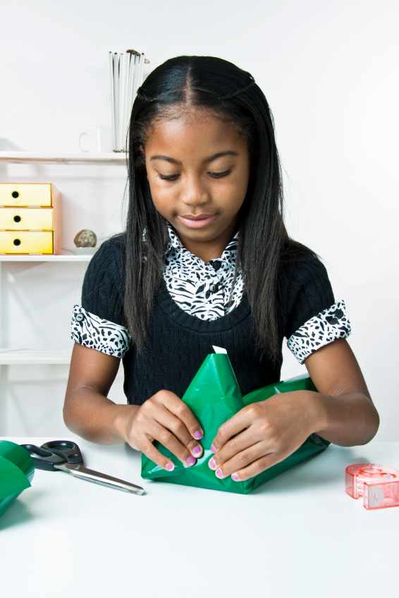 Girl wrapping gifts
