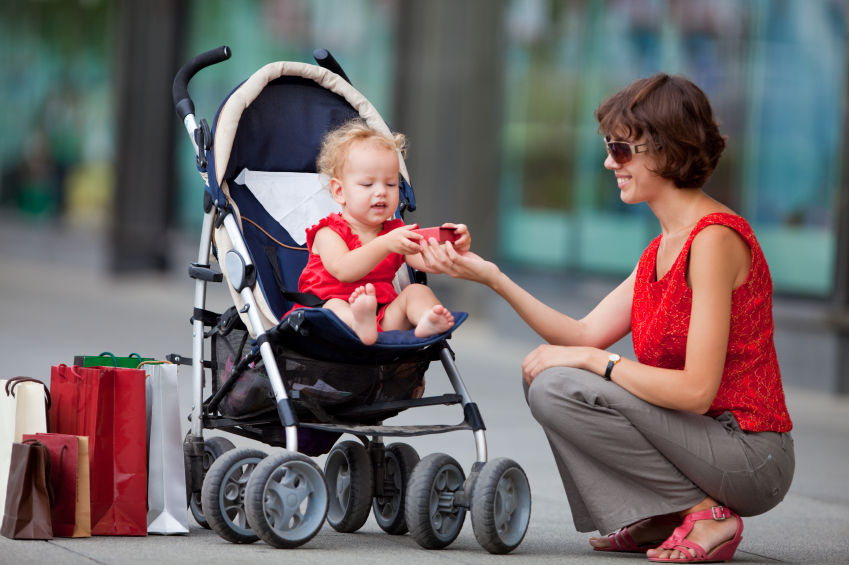 Mom shopping with toddler in stroller