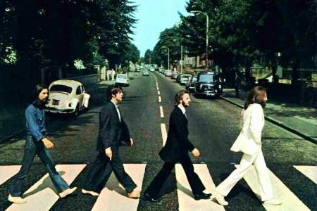 The Beatles walk Abbey Road