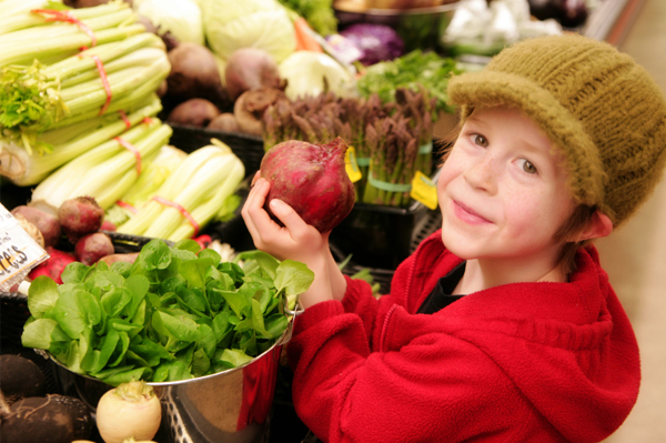 Boy with vegetable