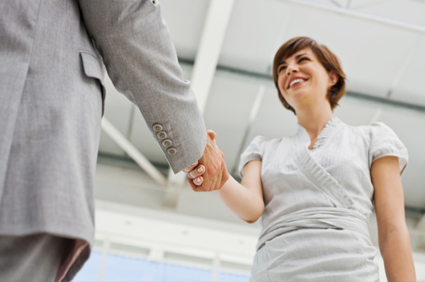 Confident woman shaking hands