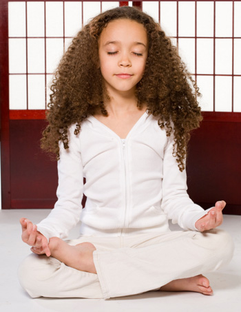 young girl doing yoga