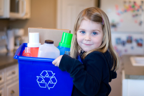 Little girl recycling