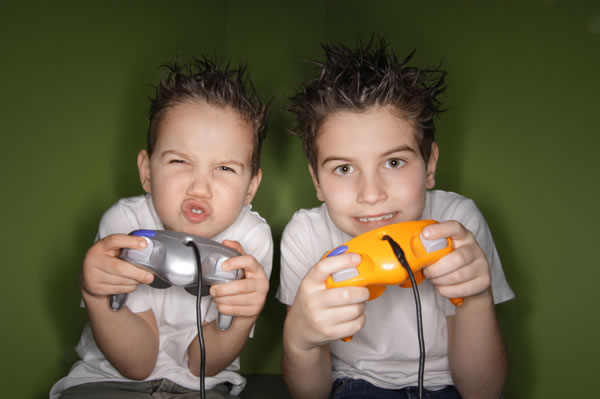 Little boys playing video game