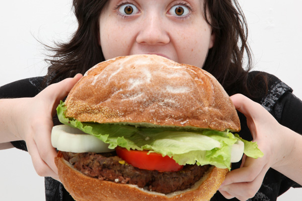 http://cdn.sheknows.com/articles/2010/12/woman-eating-giant-burger.jpg
