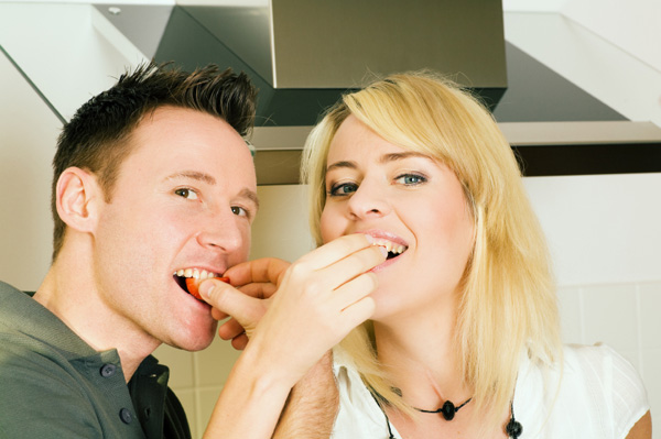 Couple eating strawberries.