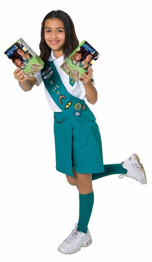 Girl scout selling cookies