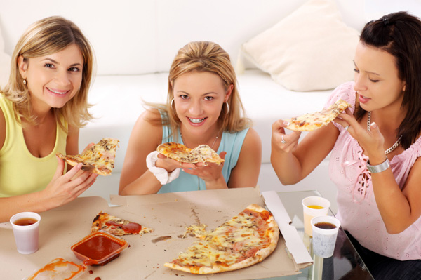 Woman eating delivery pizza