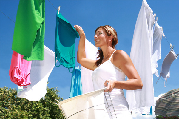 Woman hanging clothes to dry